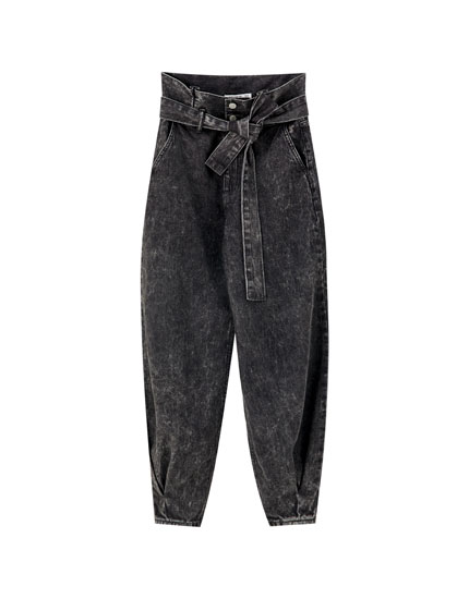 Black slouchy jeans with belt