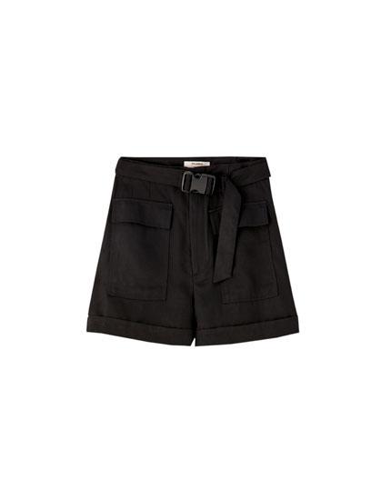 Black loose-fitting cargo Bermuda shorts