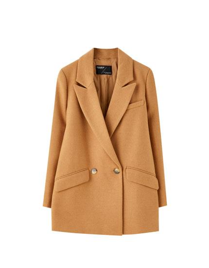 Dobbeltradet jakke i syntetisk uld