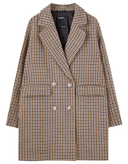 Frakke med fire knapper