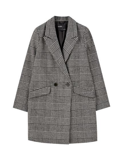 Ternet frakke i filt