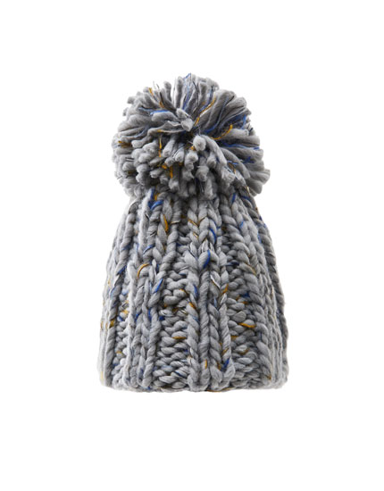 Coloured knit pompom hat
