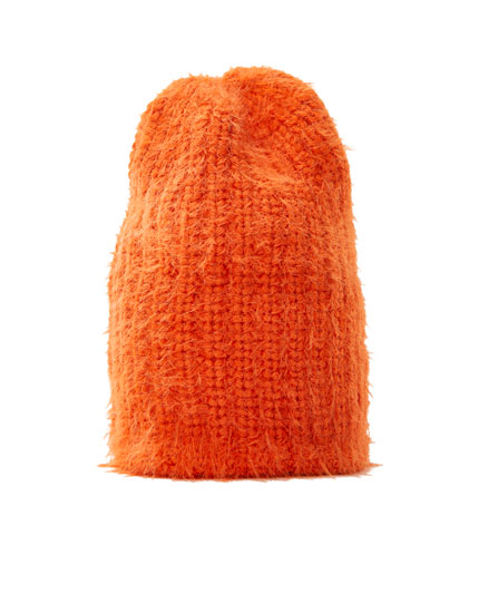 Coloured short pile fuzzy knit beanie