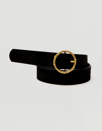 Belt with round gold buckle