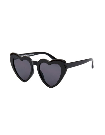 Sunglasses with heart-shaped frame