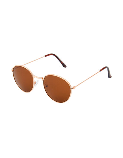 Oval sunglasses with brown lenses