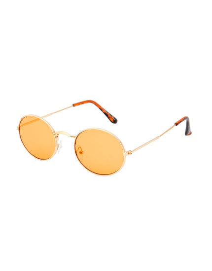 Oval sunglasses with tinted lenses