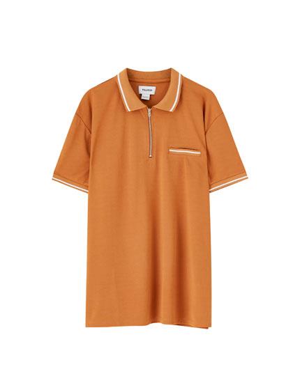 Camisa polo de manga curta com fecho de correr
