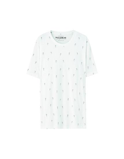 T-shirt branca com esqueletos a dançar
