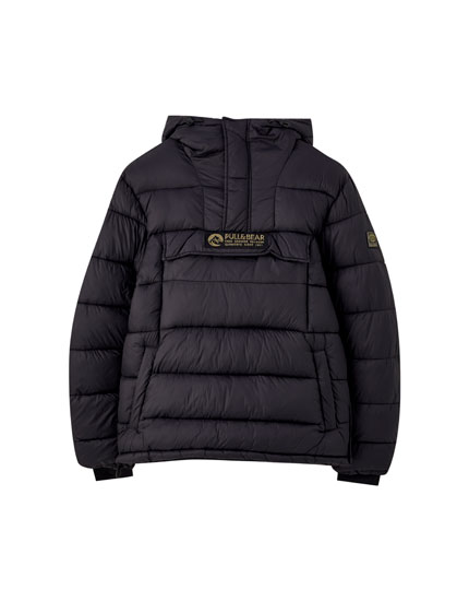 Puffer jacket with pouch pocket and patch