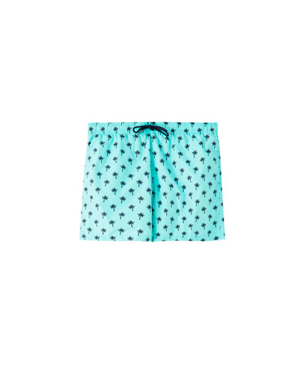 Blue palm tree print swim trunks