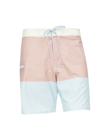 Striped surfer-style board shorts