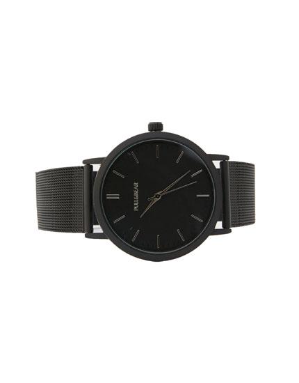 Relógio preto com face oval
