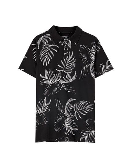 Black polo shirt with tropical leaf print