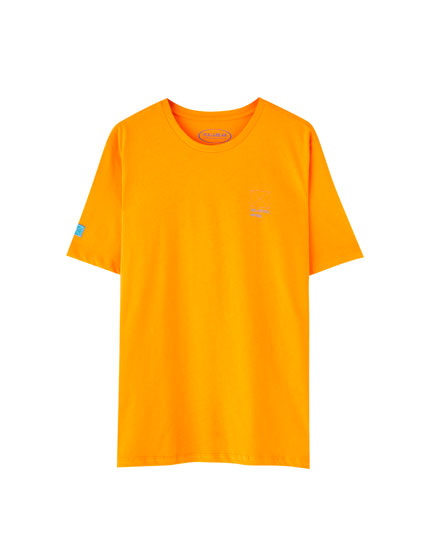 Orange T-shirt with an illustration and slogan