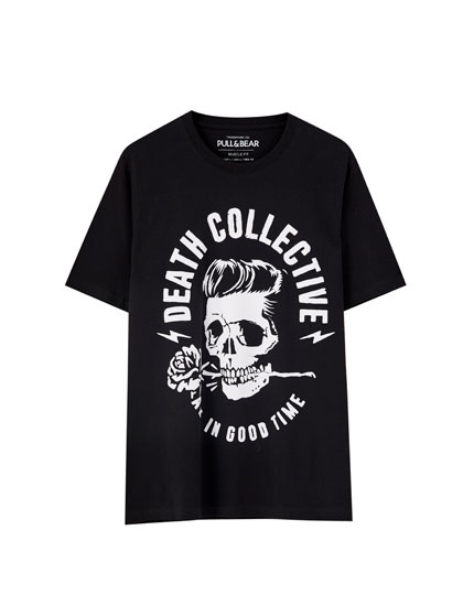 T-shirt featuring a slogan and a skull with a rose