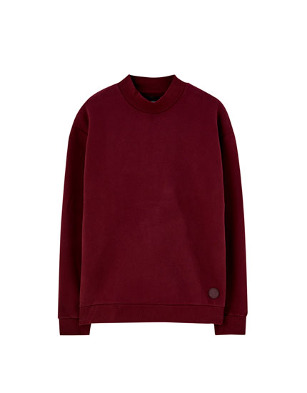 Sweat col montant poches