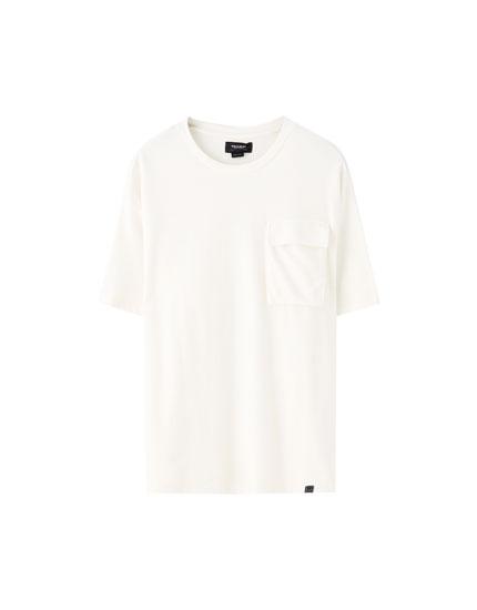 Camiseta oversize bolsillo