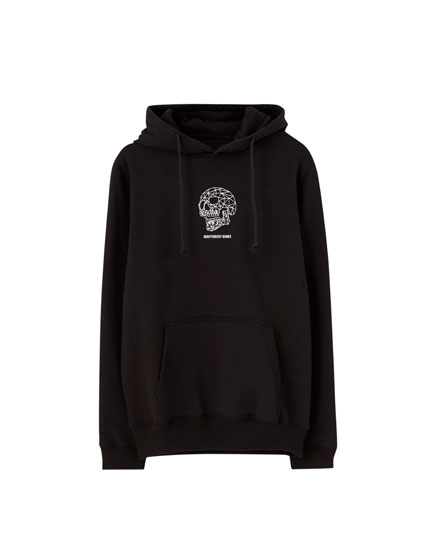 Black hoodie with slogan and skull print