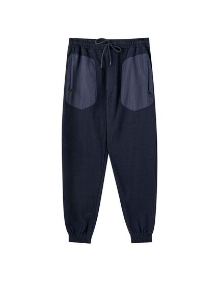 Pantalón jogging bolsillos combinados