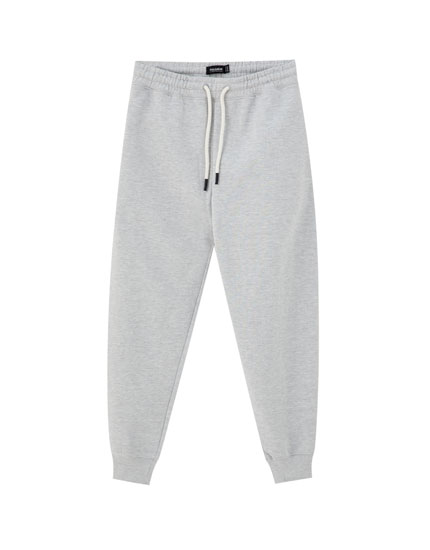 Grey jogging trousers with embroidery
