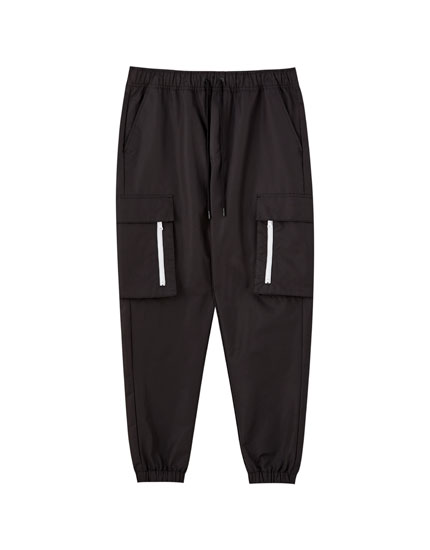 Nylon cargo trousers with zips