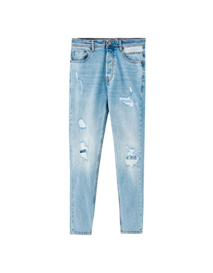 Jeans carrot fit desgastado rotos