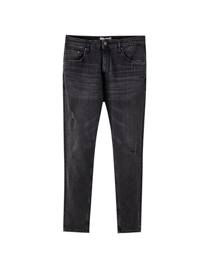 Jeans carrot fit negros rotos