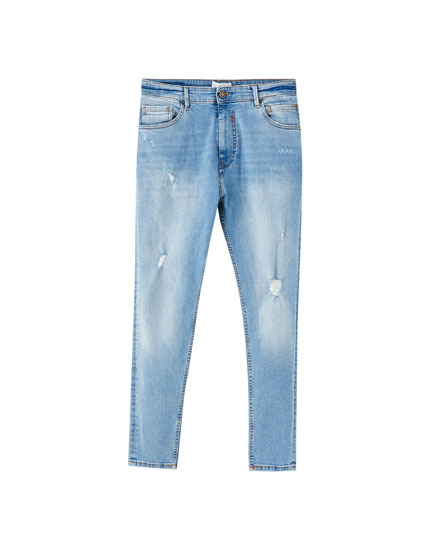 Ripped blue carrot fit jeans