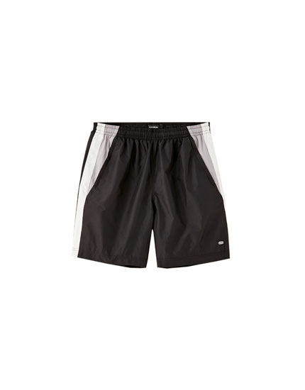 Black nylon Bermuda shorts