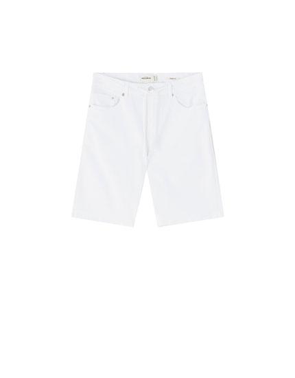 White skinny denim Bermuda shorts