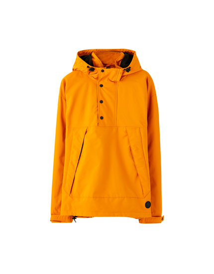 Jacket with pouch pocket and buttons