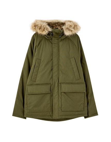 Καπιτονέ παλτό με τσέπες
