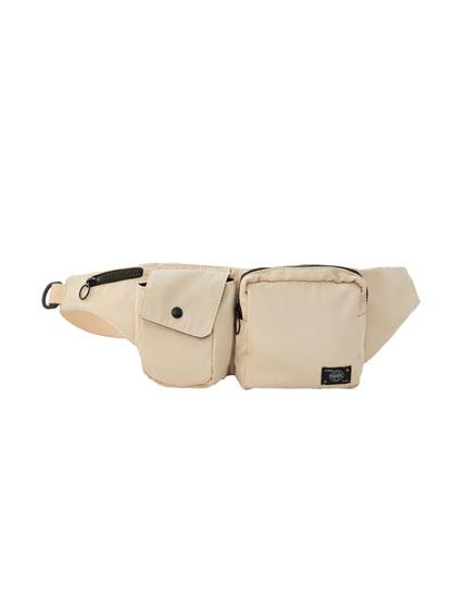 Sand-coloured belt bag with multiple pockets