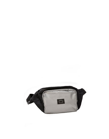 Belt bag with contrast reflective pocket