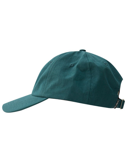Green curved peak cap