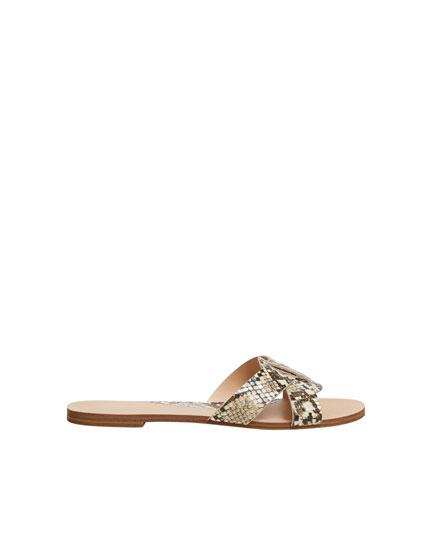 Animal print criss-cross vamp sandals