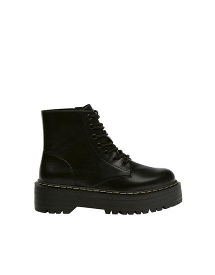 Black platform sole boots