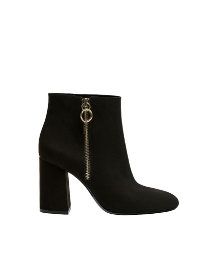 Black heeled ankle boots with zip