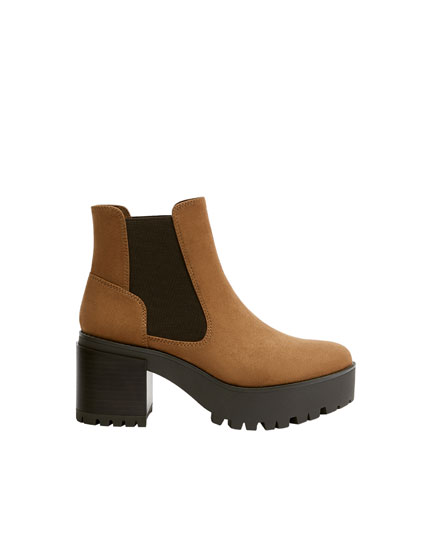 Brown high-heel ankle boots with gores