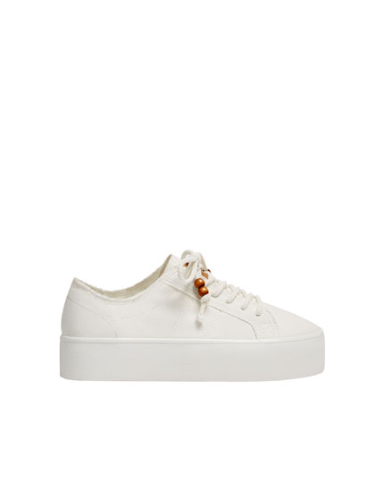 Sadie Sink trainers with beaded laces