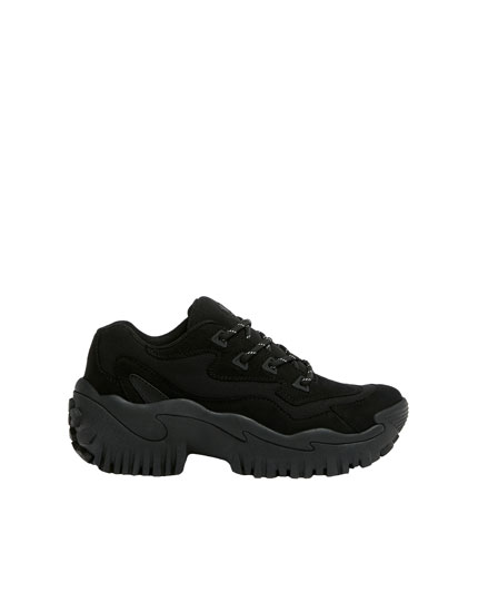 All-black fashion trainers