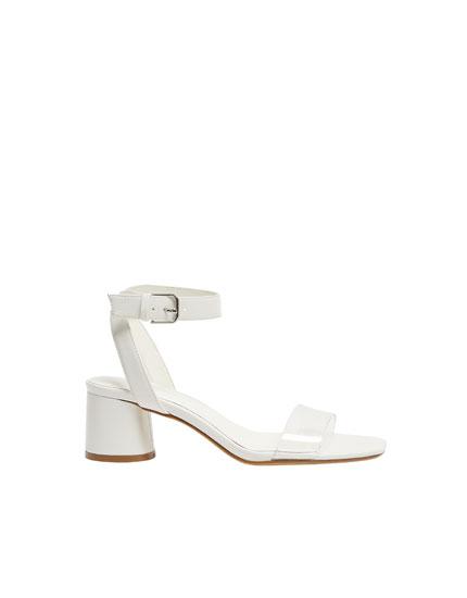 Heeled sandals with vinyl