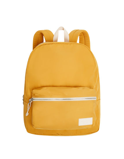 Yellow backpack with a logo