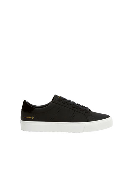 Leather die-cut trainers