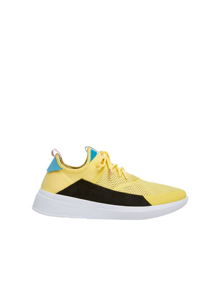 Yellow trainers with corduroy side panel