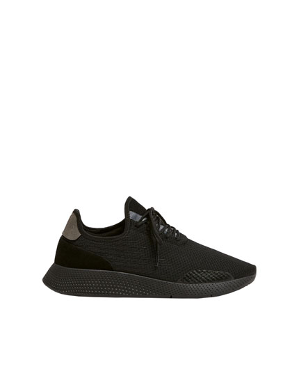 Black trainers with side details