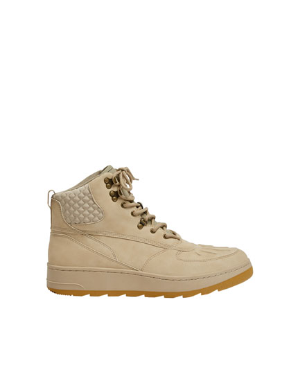 Sand-coloured hiking-style boots