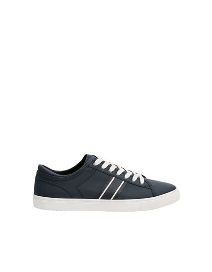 Blue trainers with side stripes