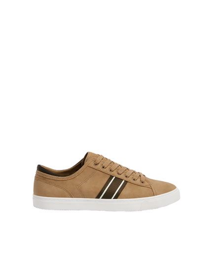 Brown trainers with side stripes